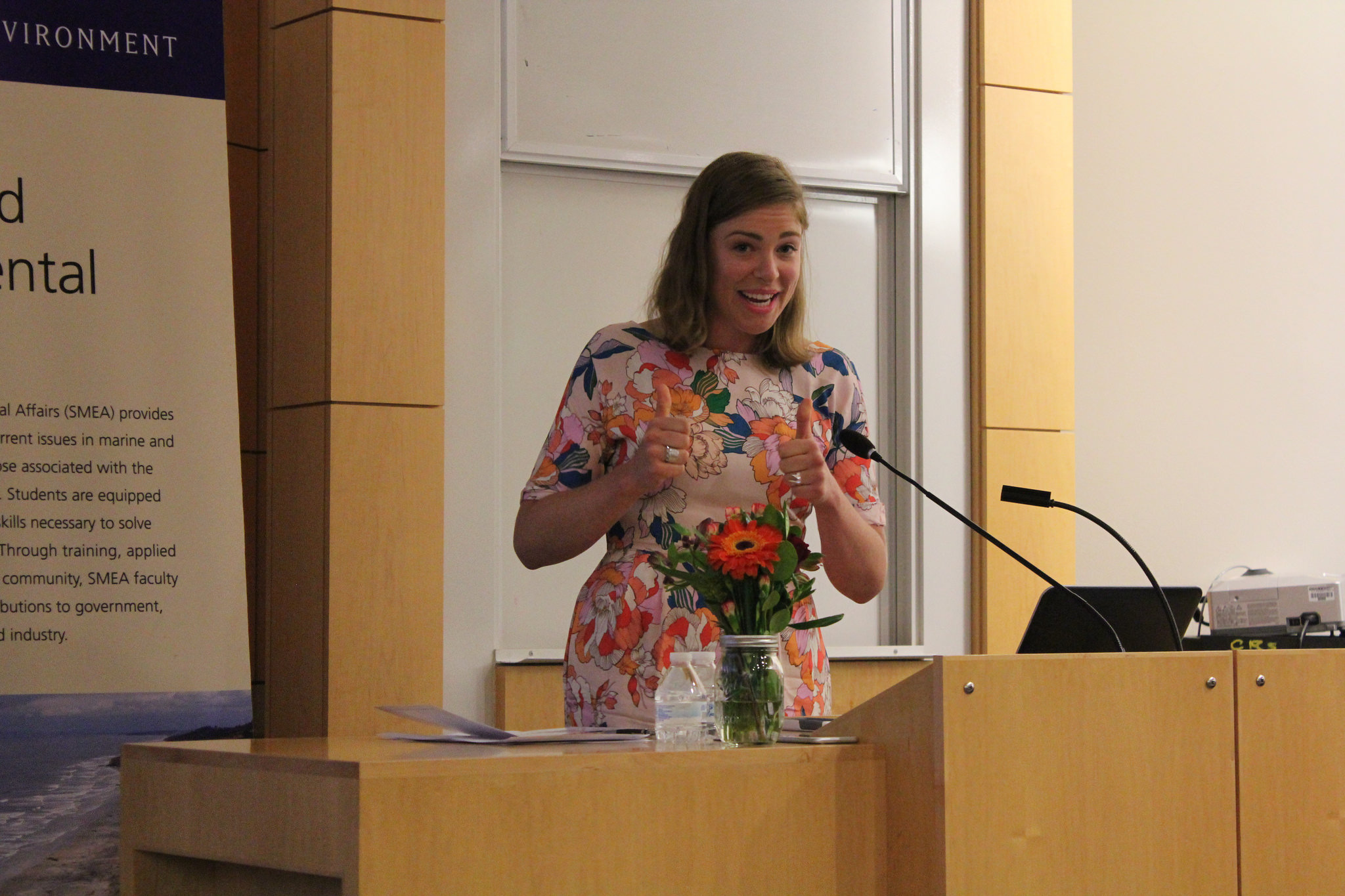 Claire Dawson speaks to her fellow class as one of two student speakers.