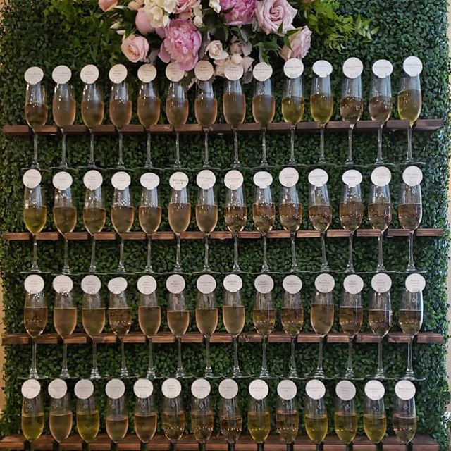 Cheers 🥂 to a beautiful 4th of July Weekend and congrats to Anita & Dan! . Champagne wall brought to you by: @juniperandlaceevents @blackstarfarms  @bloomfloraldesign  @307events