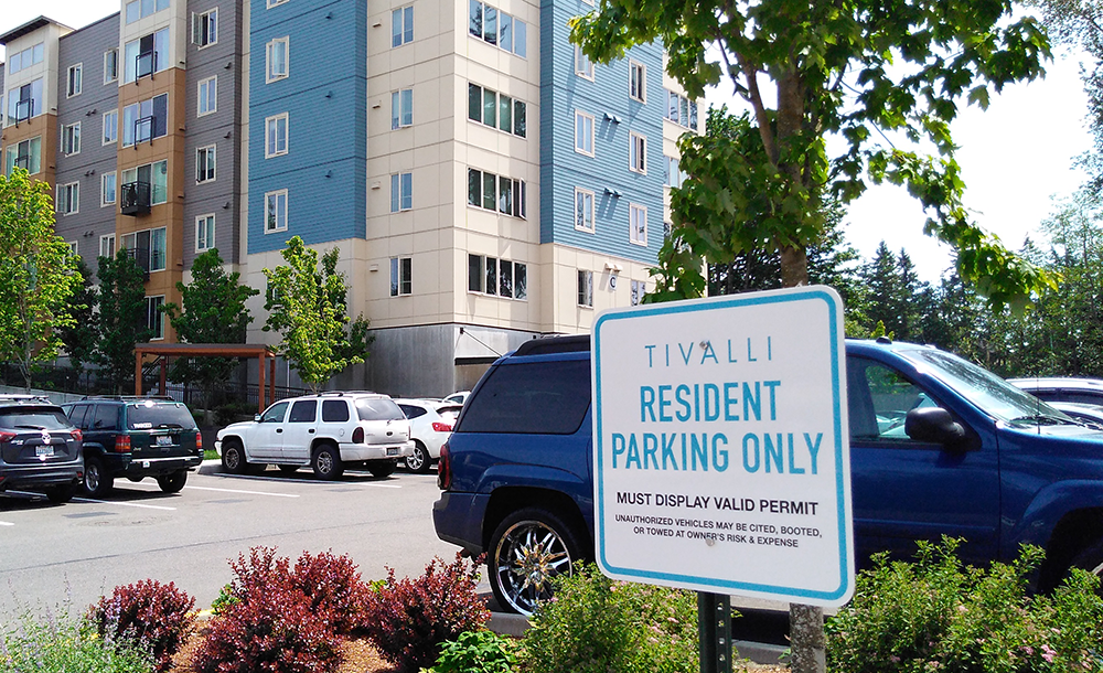 Resident Parking Only parking signs at Tivalli Apartments let visitors know where not to park.