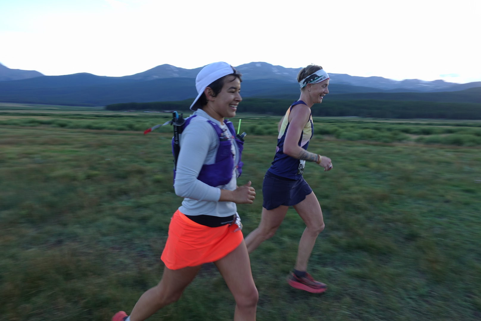 Smiling happy girls rocking Oiselle skirts. Photo by Sufferfest Beer!