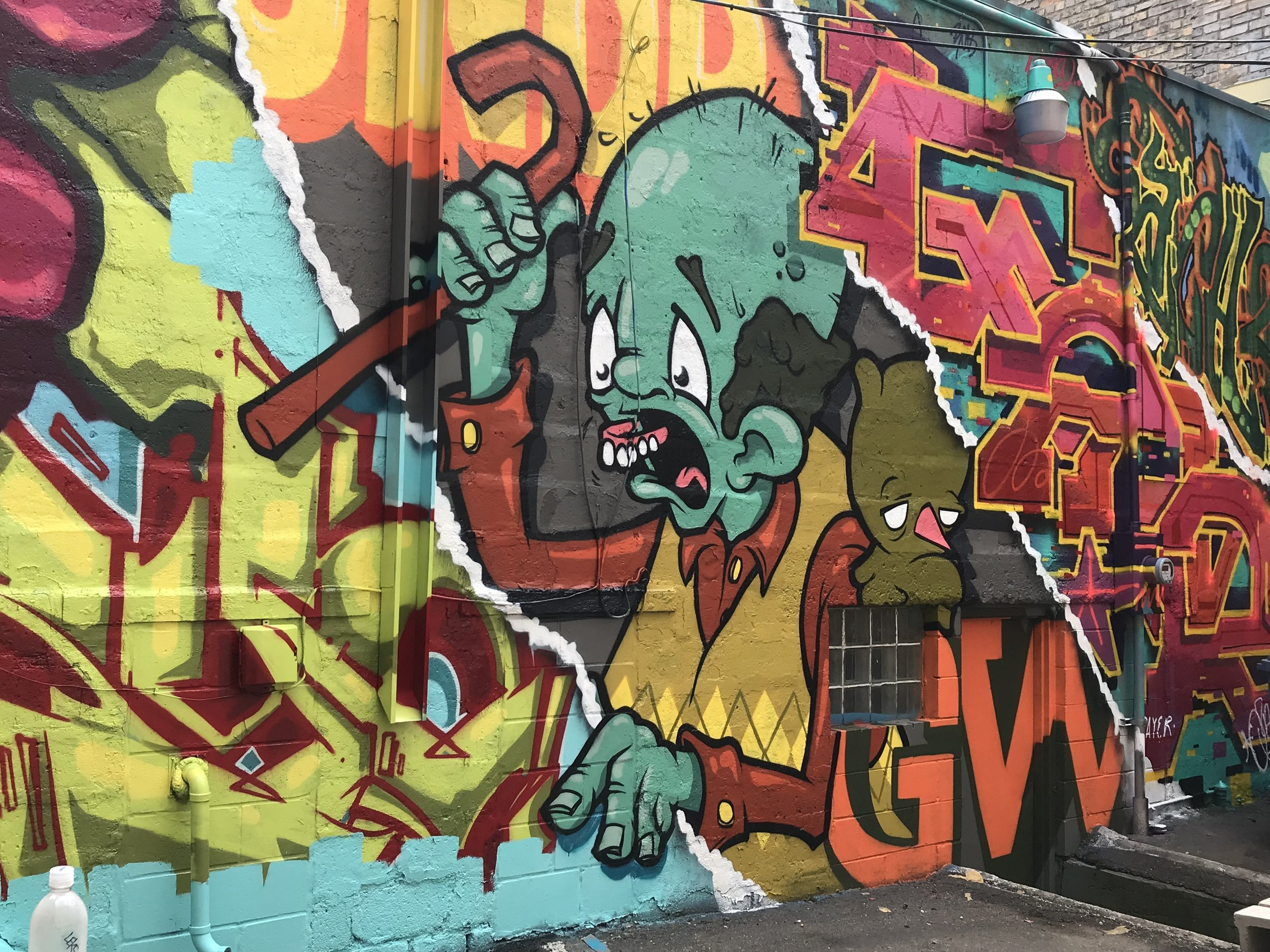 MURAL BEHIND lEGACY gLASSWORKS MADE DURING LYN LAKE STREET ART SERIES 2018  aRTISTS FROM LEFT TO RIGHT: RYOE/bIFRA/QZAR/EACH2