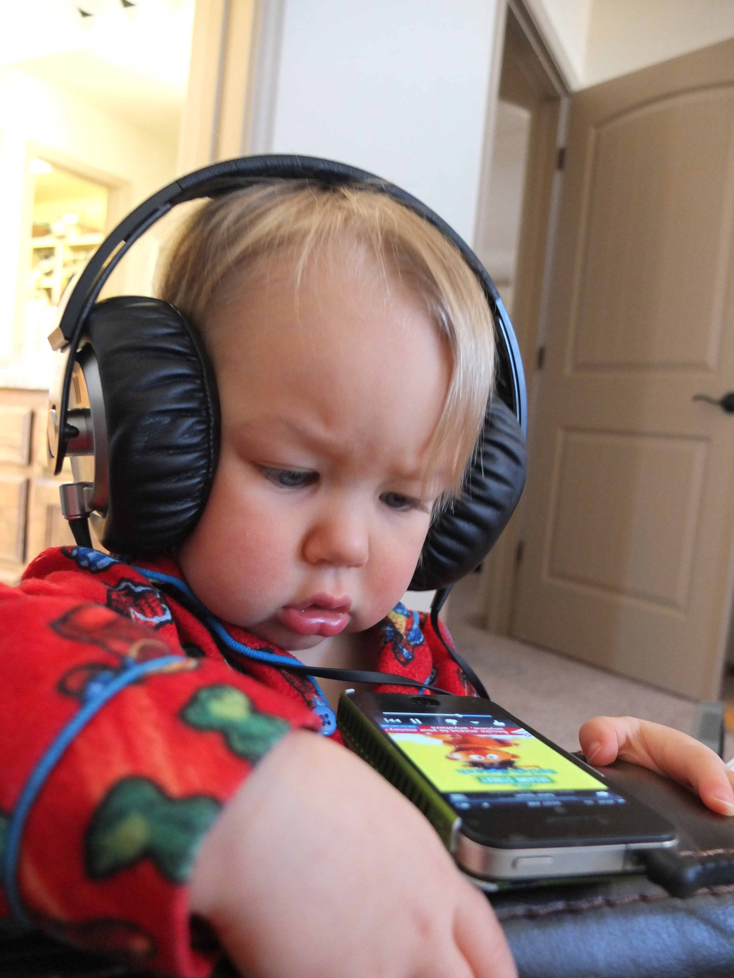 You can see from Baby Gaby's face that listening to new music gets your brain going. Ernie was new stuff for him. Ah the days. He's so little and cute here. My baby is getting too big.