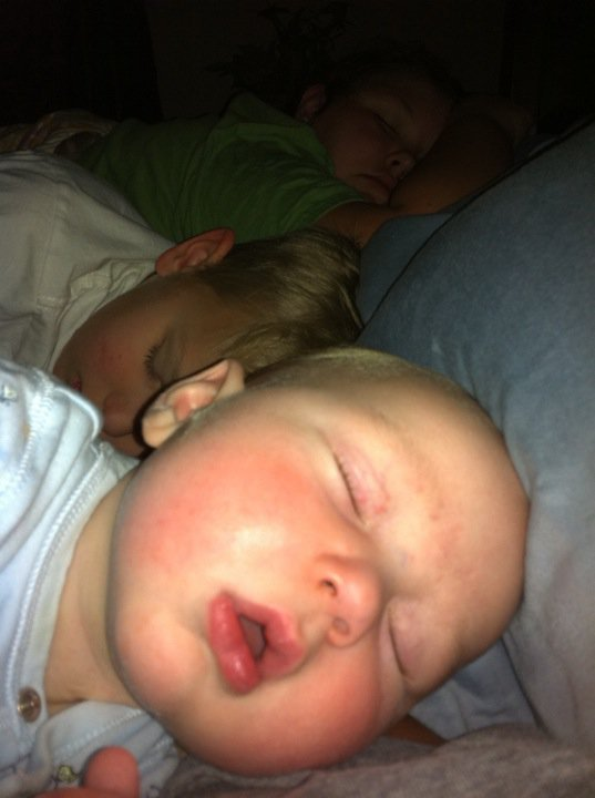 Three kids piled up in my bed the night before James got home.
