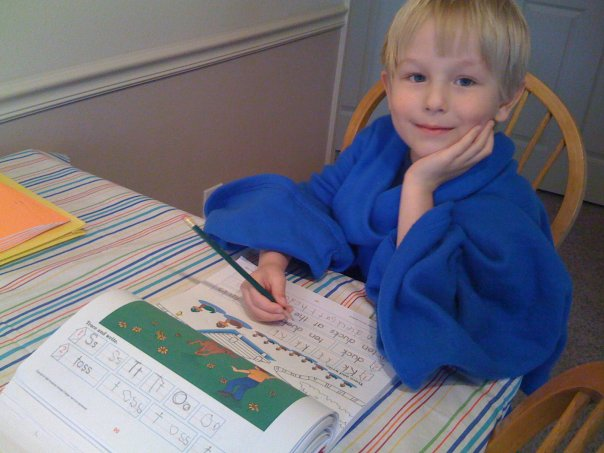 My favorite home school picture ever.  Our middle child doing Kindergarten in a Snuggie.