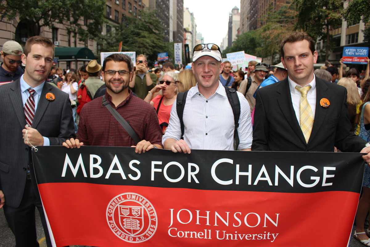 Jeremy Kuhre, left, organized a group to attend the People's Climate March