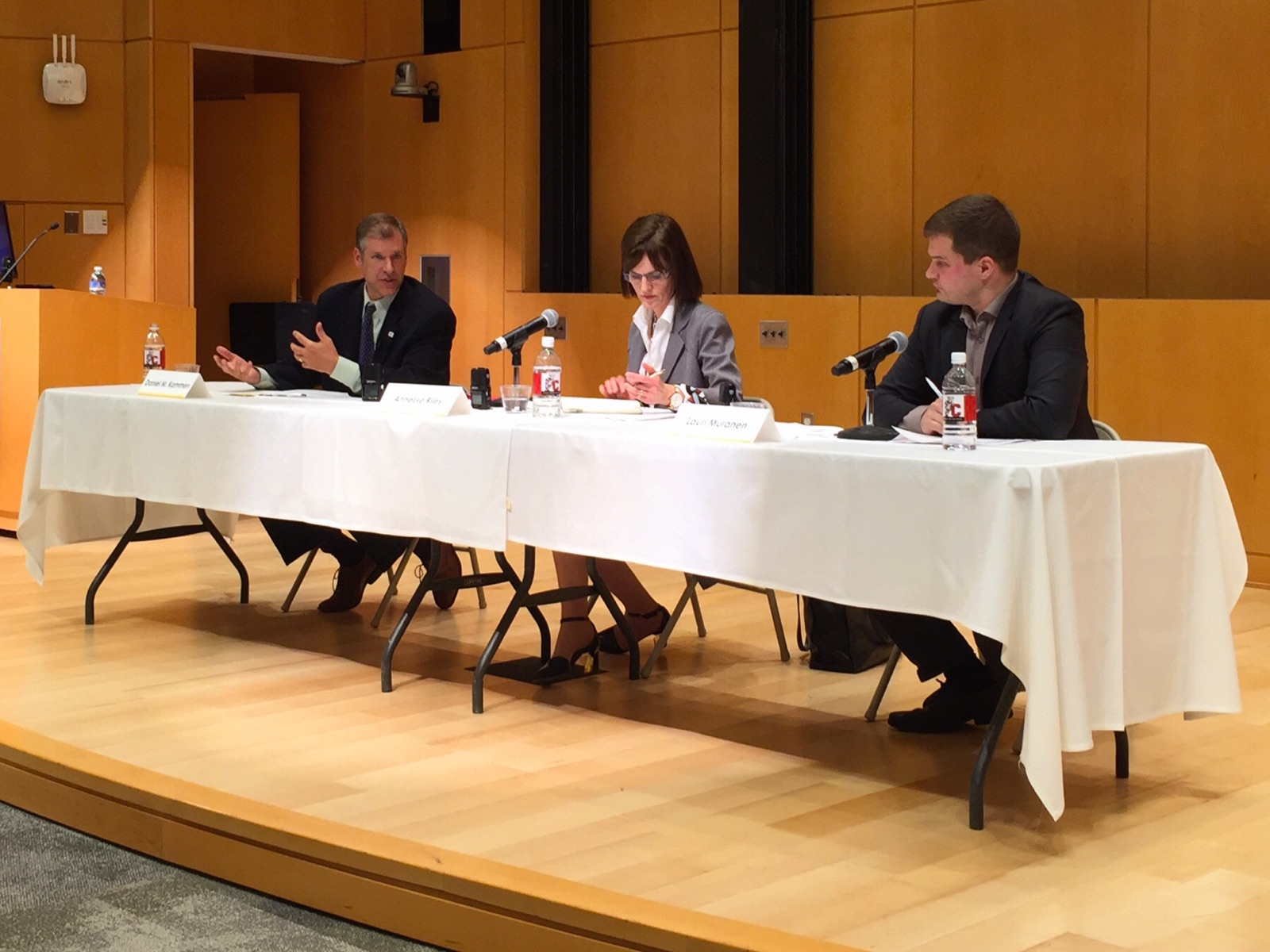 Daniel Kammen (left) debates with Lauri Muranen (right) on the future of nuclear. Annelise Riles of the Cornell Law School. Photo by Geoff Johnson.