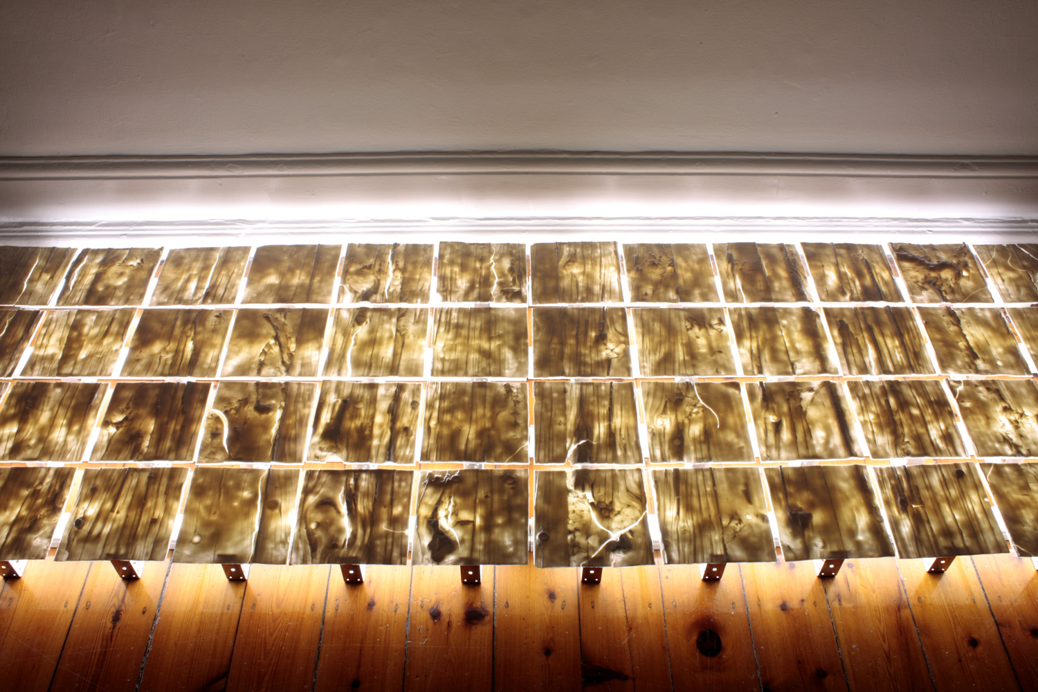 Tiled - centre lit from below Southern Ice porcelain, steel timber connectors, fluorescent lights 2009 10 x 480 x 90 cm