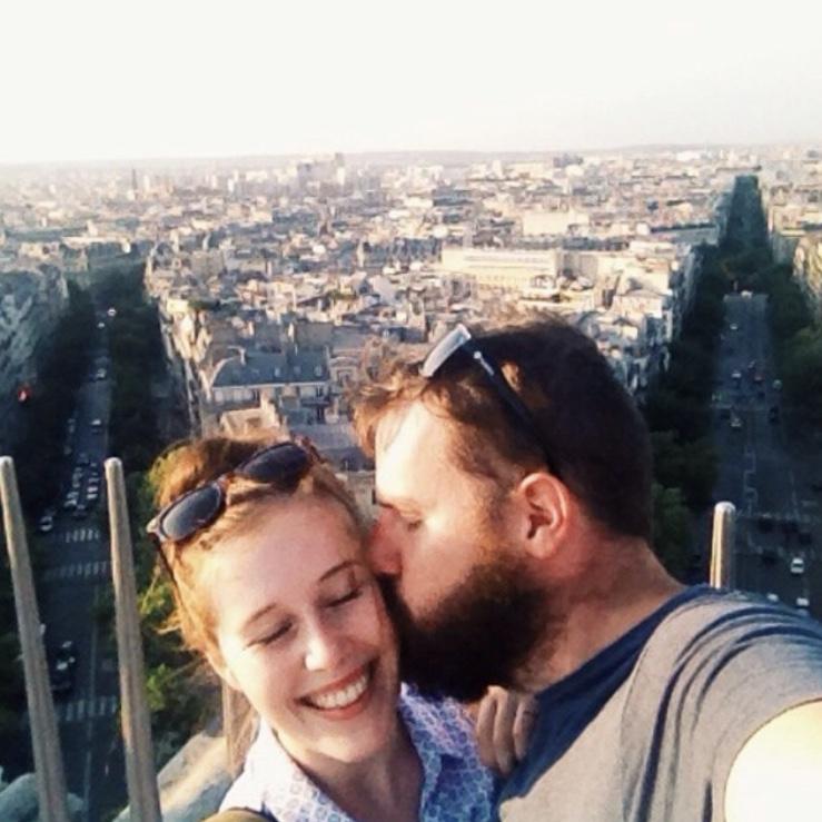 Kisses atop the Arc de Triomphe in Paris