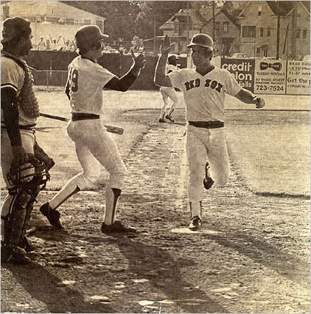 Wade Boggs congratulates the winning run of the longest game in baseball history.