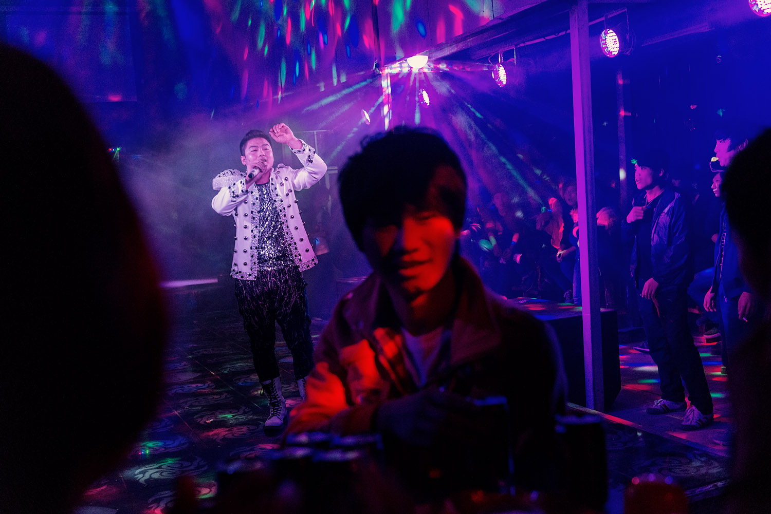 During a performance, at a club, in Foxconn factory town on the outskirts of Zhengzhou.
