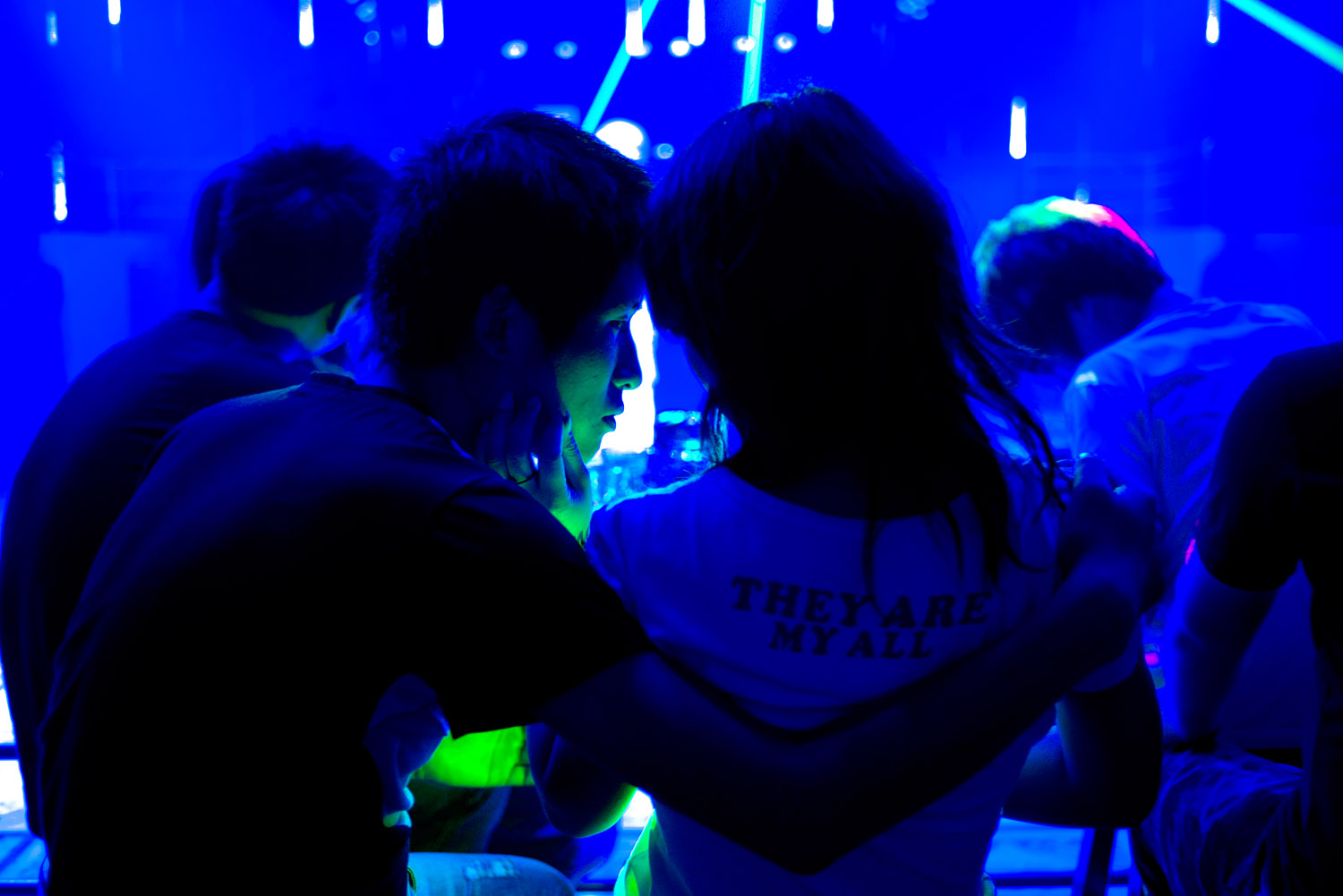 A young couple at a club. Among Foxconn workers many young couples who came to this factory town together, or found romance there. Foxconn dorms have a strictly enforced gender segregation, requiring couples to rent rooms in the city.