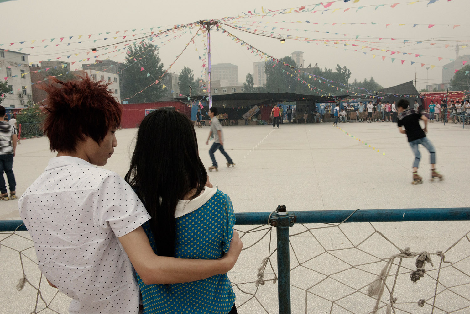 A young couple by a skating ring. Skating is one of the most popular out-of-work activity for the Foxconn workers here.