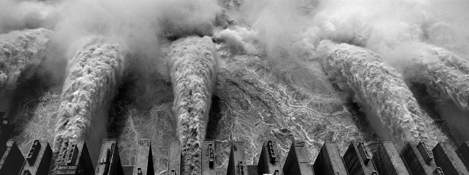 The water flows out of the turbines of the three gorges dam on the Yangtze river.