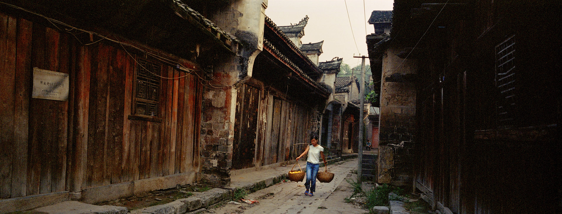 Dachang, a city of over 1700 years of history a few months before its destruction ahead of theflooding. The centuries old houses, typical of Ming rural architecture are already empty of their inhabitants who have relocated further up.