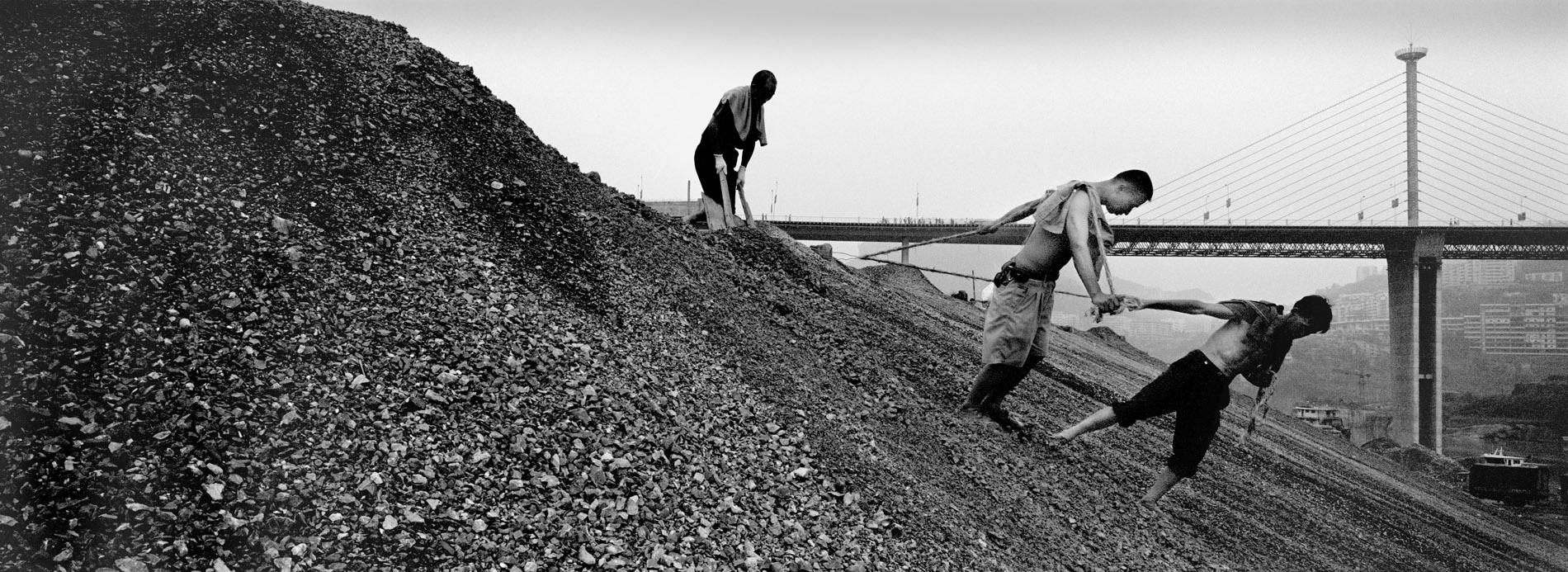 Workers consolidating the bank of the Yangtze, before the water level rises.