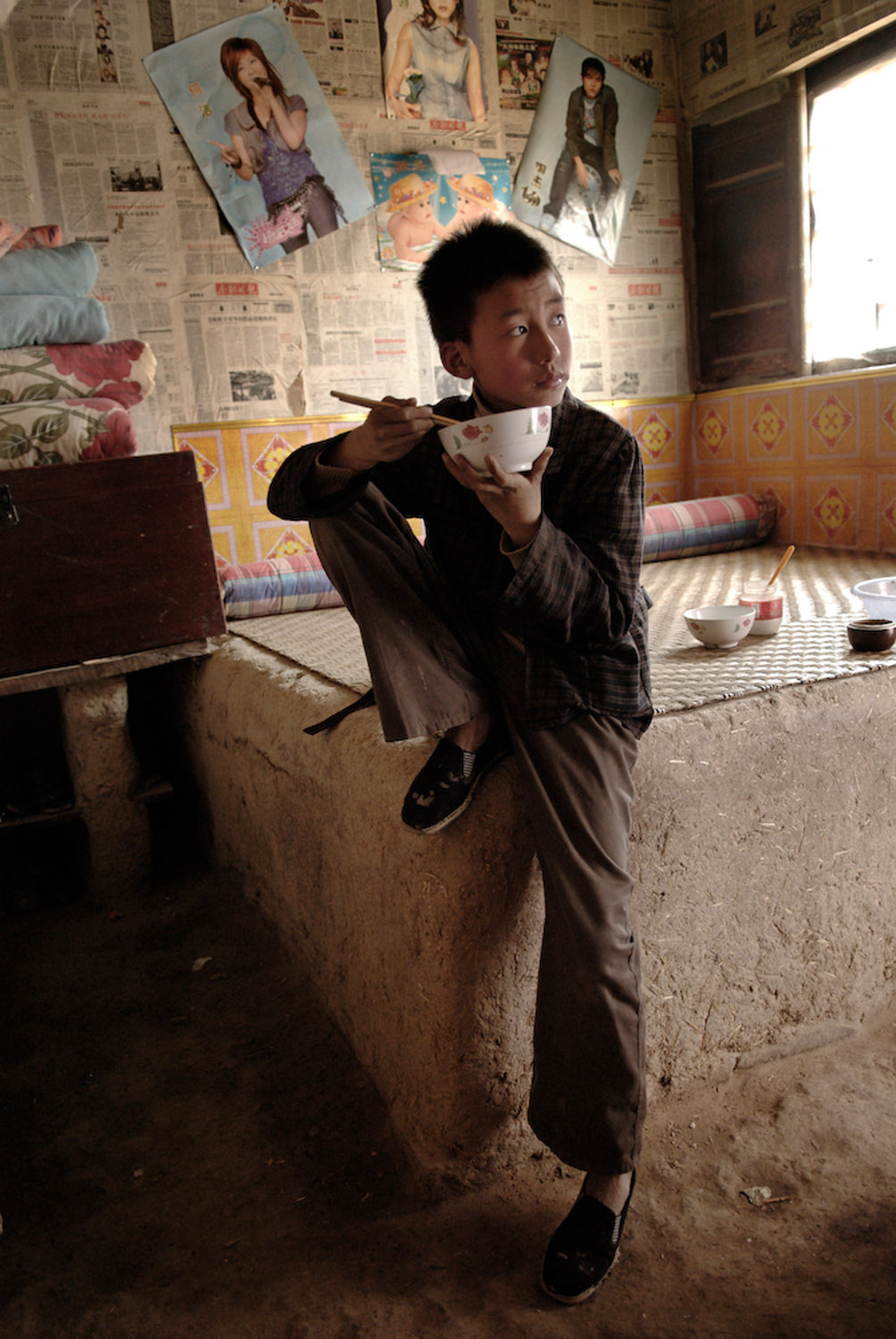 Liu Wei, an orphan, eating a bowl of noodles at his grandma's who struggles to support him.