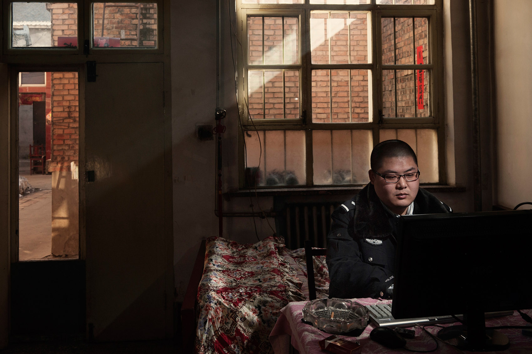 Xiangyuan (Shanxi) January 24, 2012.Li Ke a prolific author of online novels, in his room where he spends hours every day writing. Li runs a double life: policeman during the day and writer when he is not on duty.
