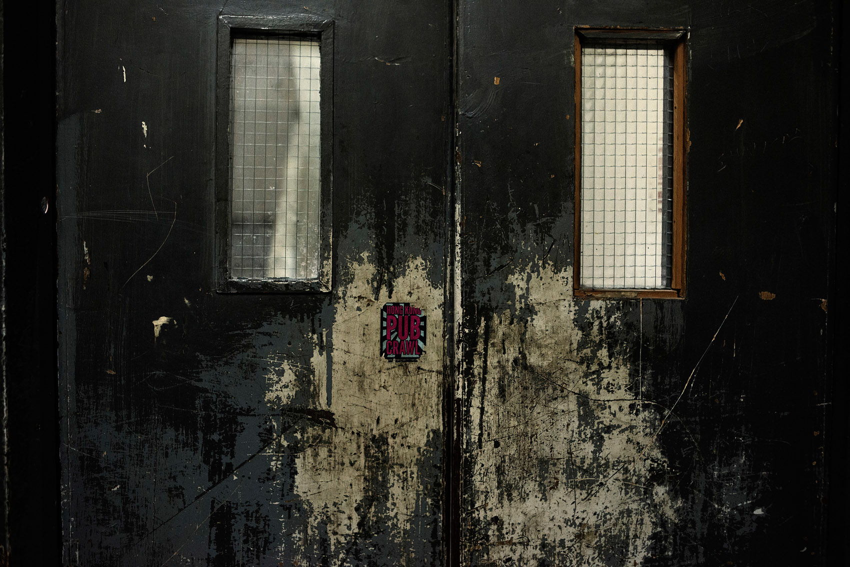 A door on a upper floor of the Chungking Mansions.