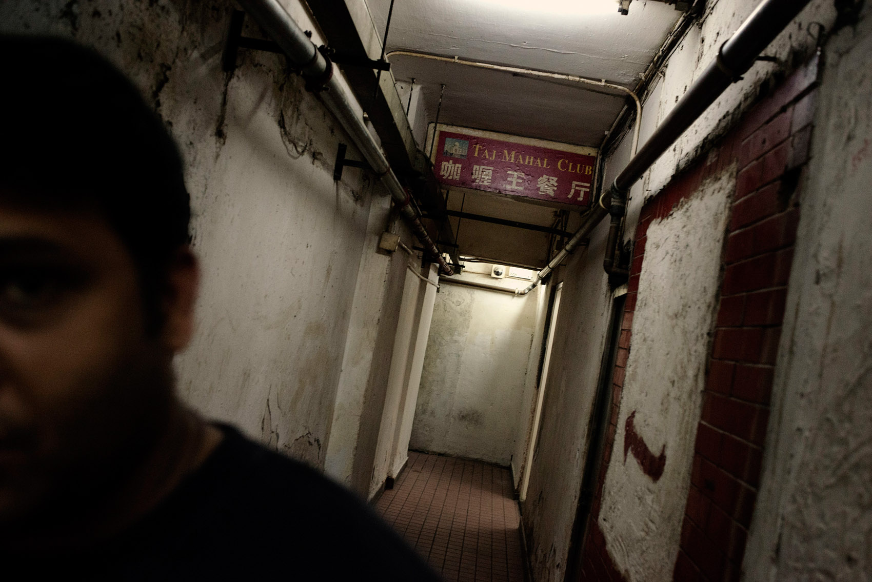 In a corridor of the Chungking Mansions leading to the Indian restaurant, the Taj Mahal Club..