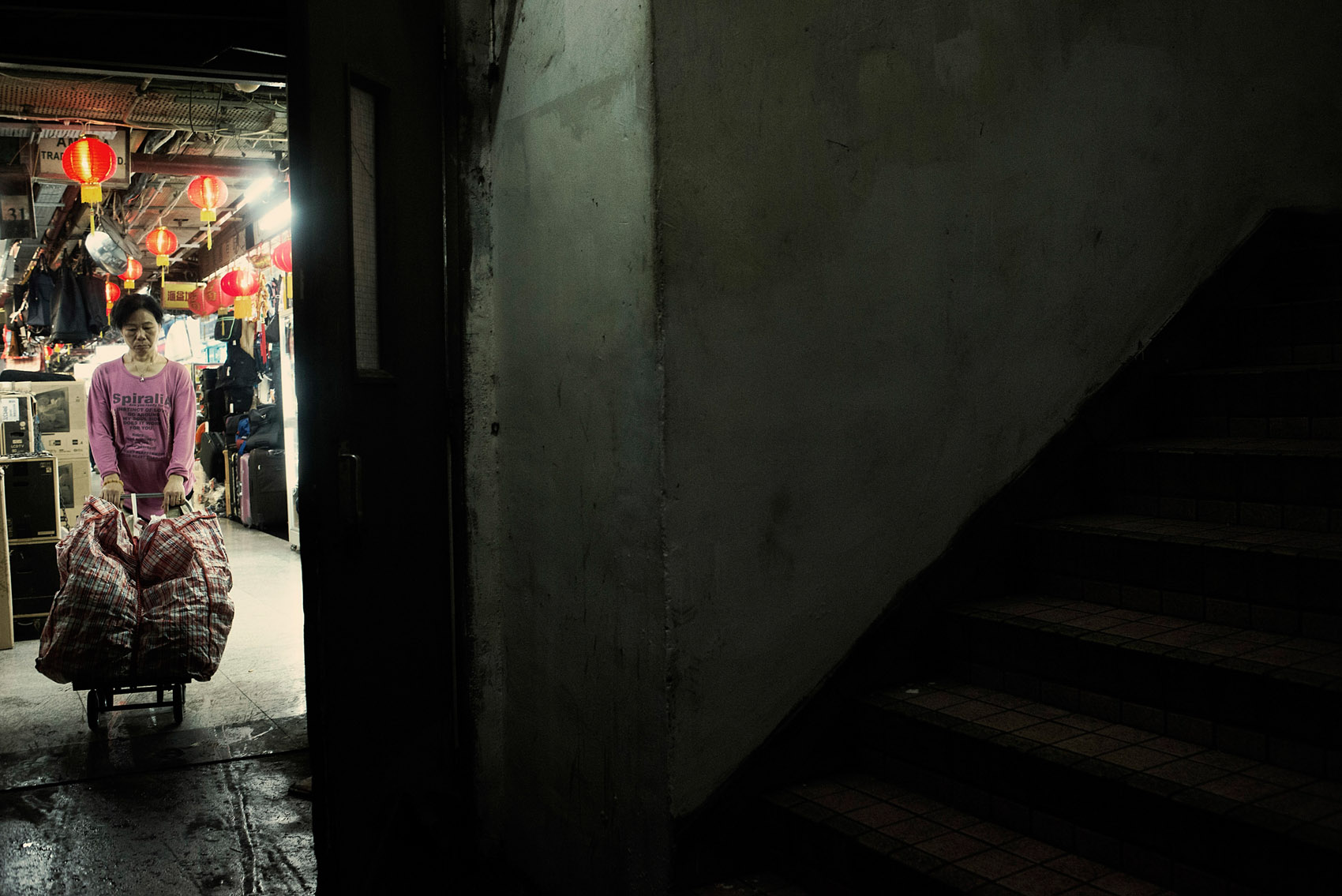 A worker of the Chungking Mansions moving goods out of the building..