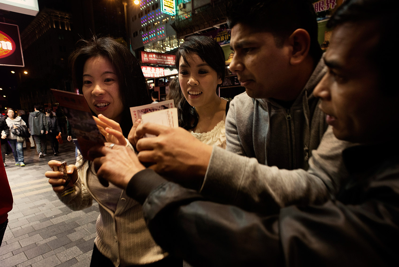 In front of the Chungking Mansions touts trying to lure locals into Indian restaurants..