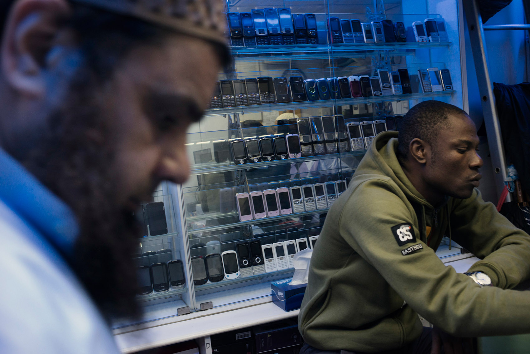 At the Chungking Mansions, in a store ran by a Pakistani businessman, an African trader is selecting mobile phones. He is planning to ship 2000 mobile phones to Douala, his ometown and the capital of Cameroon..