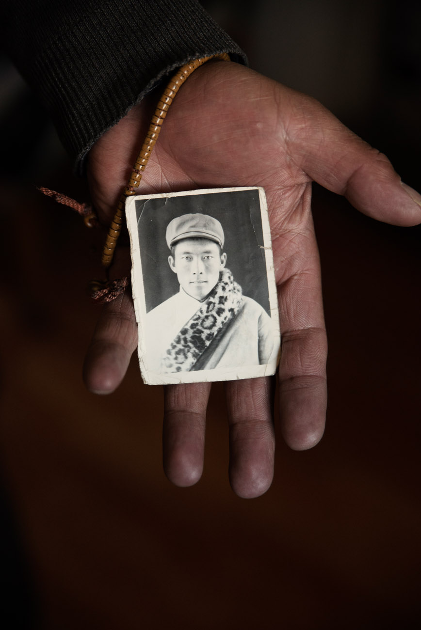 A Tibetan nomad, showing a picture of himself at the age of 25. A nationwide campaign of nomad resettlement, in the name of environment protection is pushing Tibetan to give up pastoralism for a sedentary life alien to them.