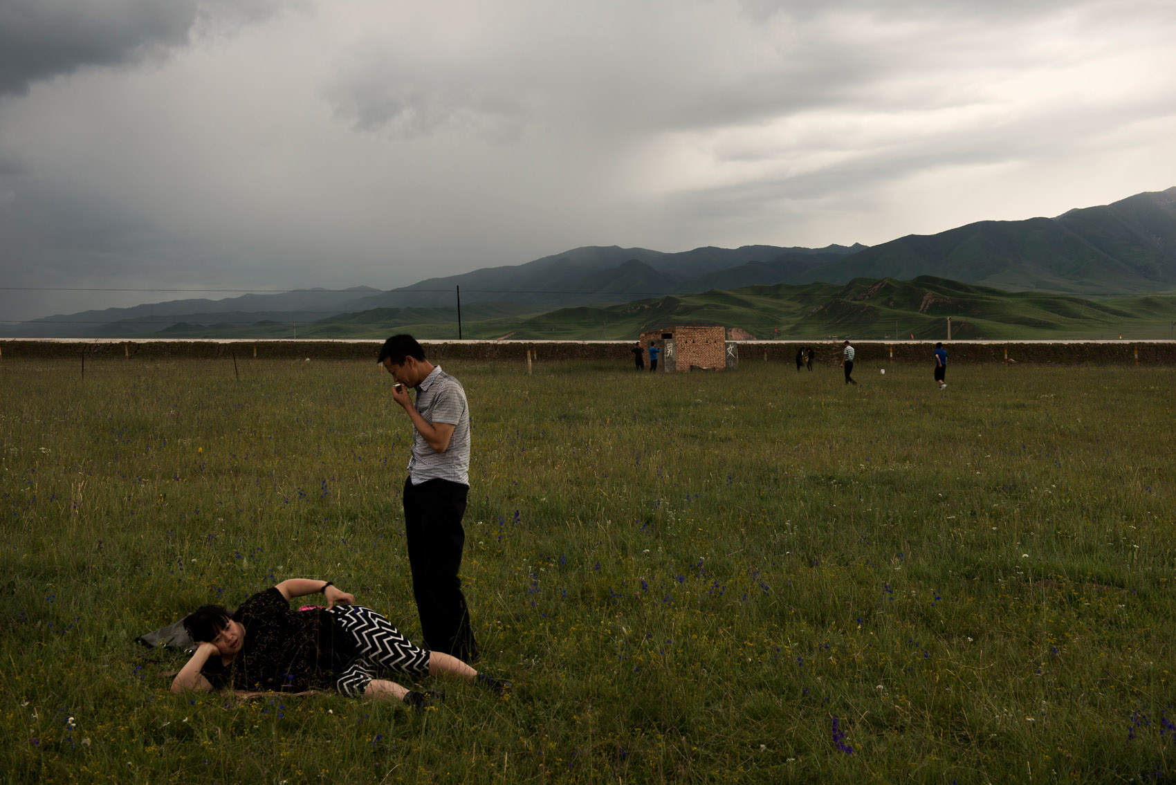 Chinese tourists enjoying the Tibetan grassland near Xiahe (Gansu). Some Tibetan nomads in the region have set-up camps for tourists, cashing on the fascination for nomadic lifestyle.. A new source of income for them as their livelihood is under threat by a resettlement plan.