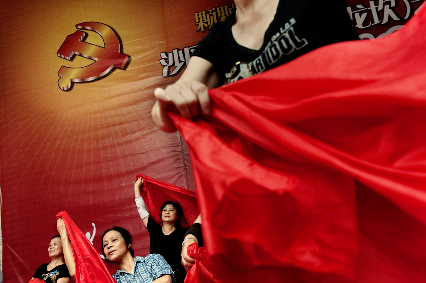 Volunteers rehearsing a revolutionary ballet in Chongqing during a campaign celebrating Mao and the revolution, initiated by local Party Secretary Bo Xilai in a bid to foster his image and popularity. Bo Xilai was subsequently arrested and condemend for corruption.