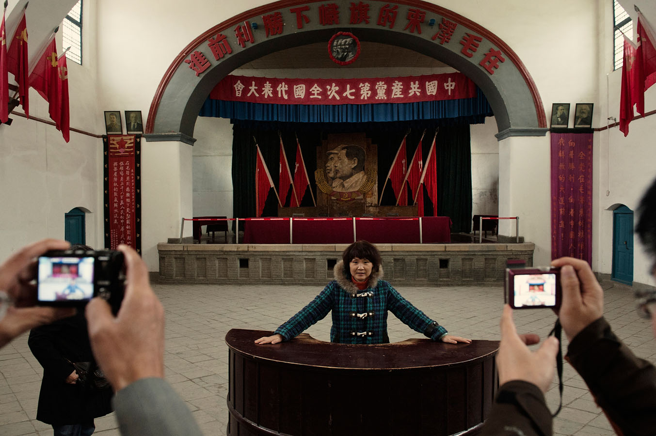 Tourists visiting Yangjialing Assembly Hall in Yan'An, from where Mao Zedong launched one of the Chinese Communist party first purge (the rectification campaign) and asserted his power as the sole leader of the Party.