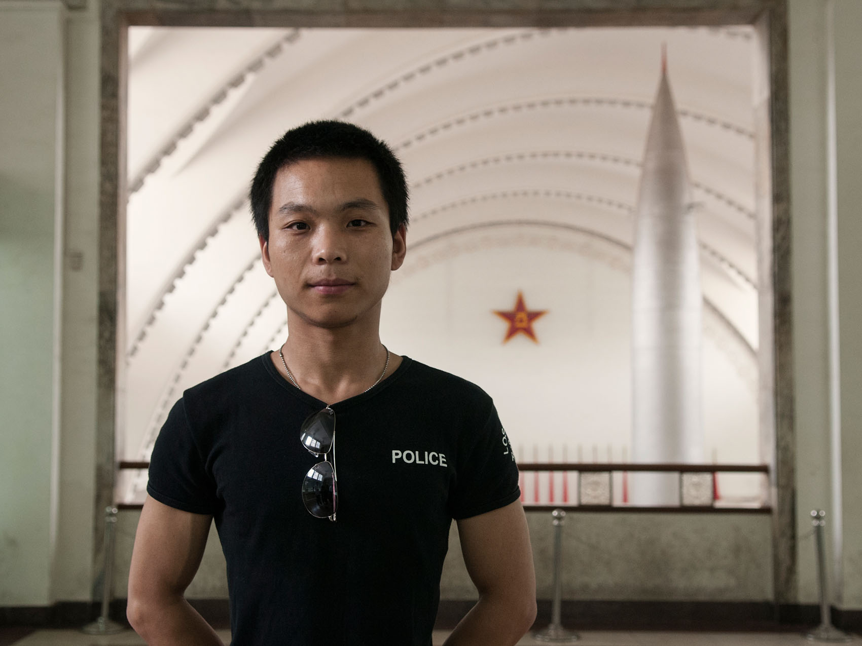 A young military enthusiast visiting the Military Museum in Beijing.