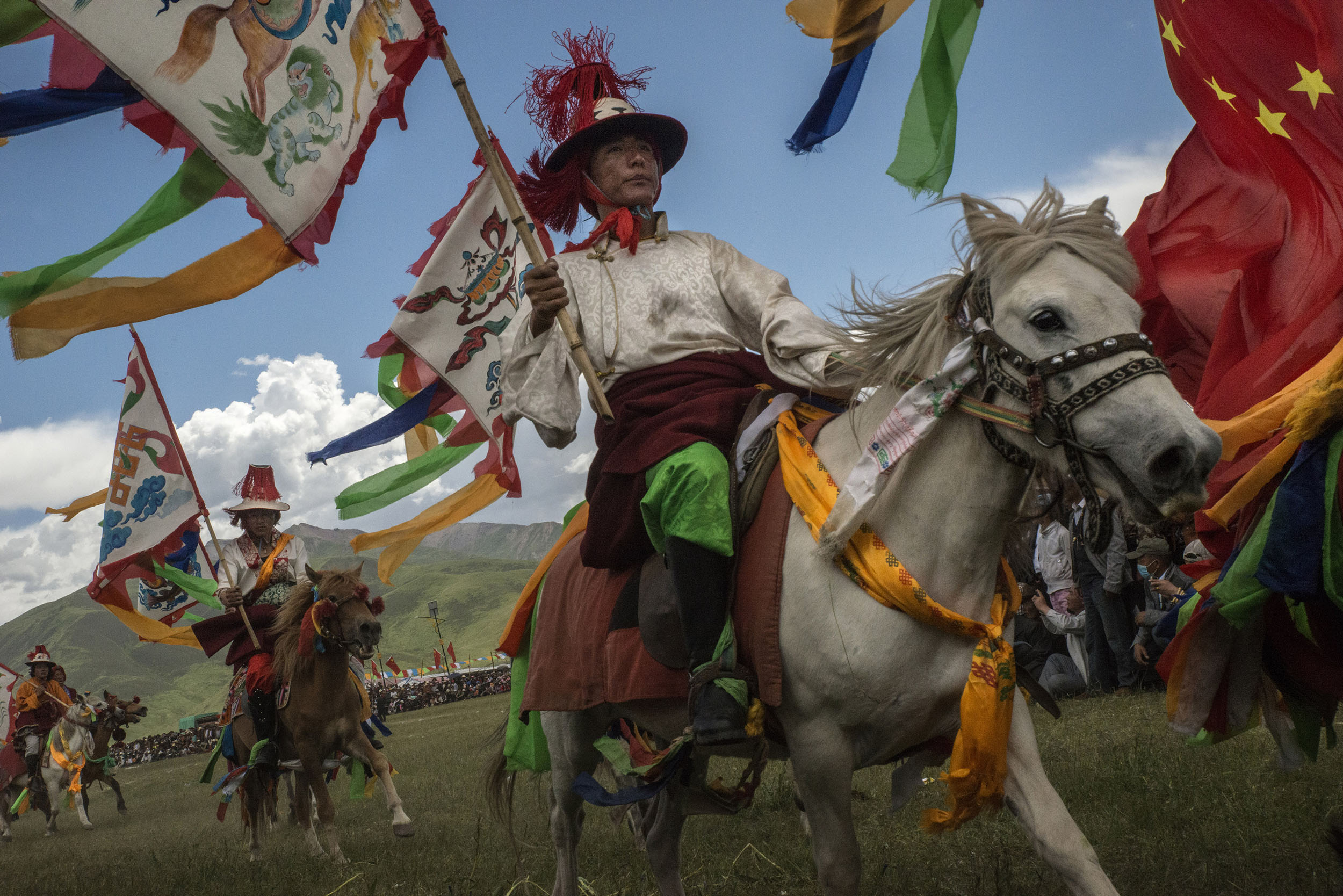 In Yushu, during a horse festival, nomads show their equestrian skills. Horse festivals are traditionally held every summer in the Tibetan grasslands and are part of the nomadic culture.Many have recently been cancelled by the government for fear of unrest. Others, such as the one in Yushu, are sponsored by the local government in an effort to boost tourism and, some say, for propaganda purposes.