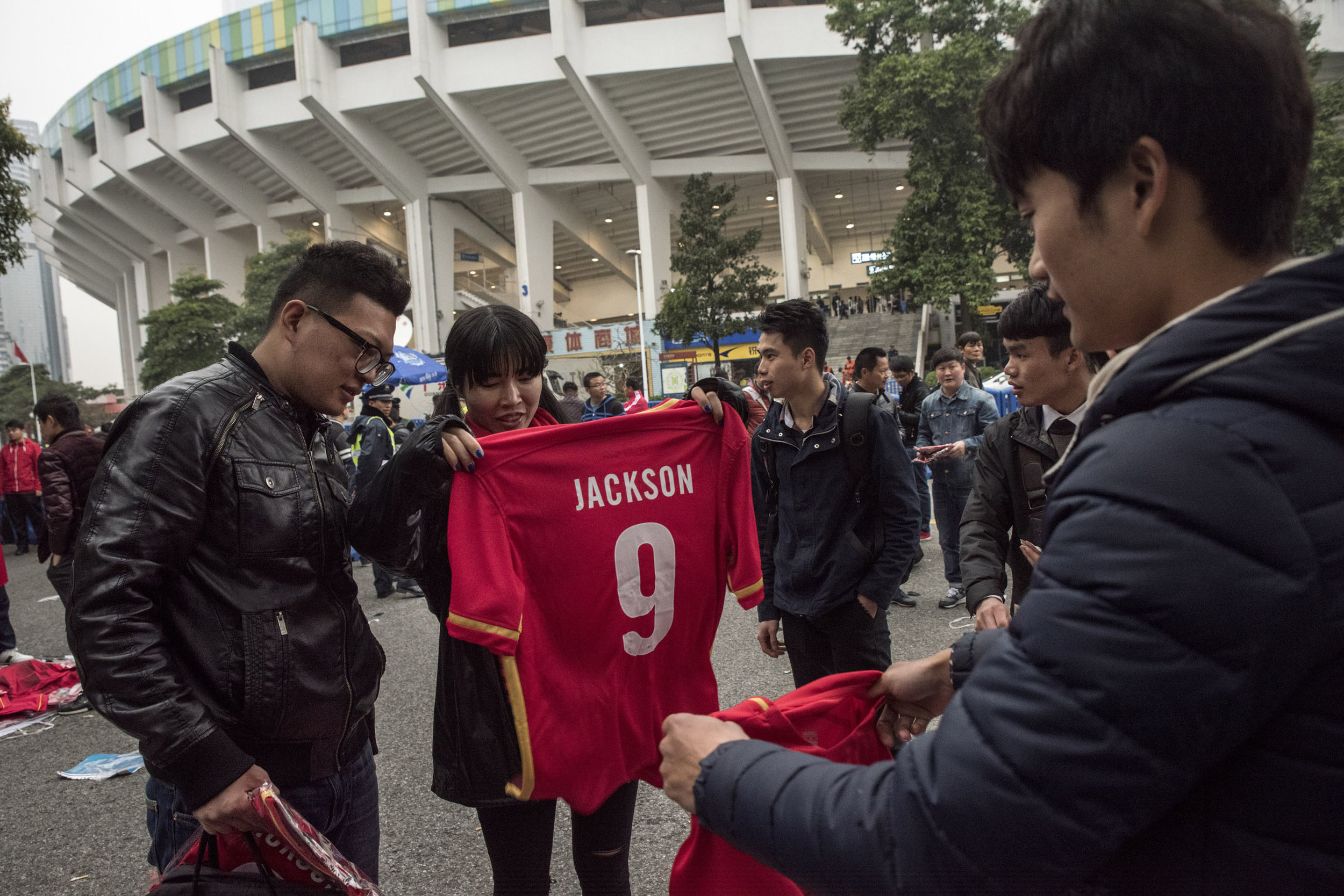 Outside The Guangzhou Tianhe stadium Evergrande supporters buying the Jackson Martinez T-shirt. The Colombian striker has been acquired by Evergrande for a whooping $46 million in 2016. He has quickly become a favourite for the club supporters.  In the main pro trading season last year, the 16 Chinese Super League teams spent over $300 million hiring away promising foreign players, outstripping player spending by the English Premier League by nearly $120 million.