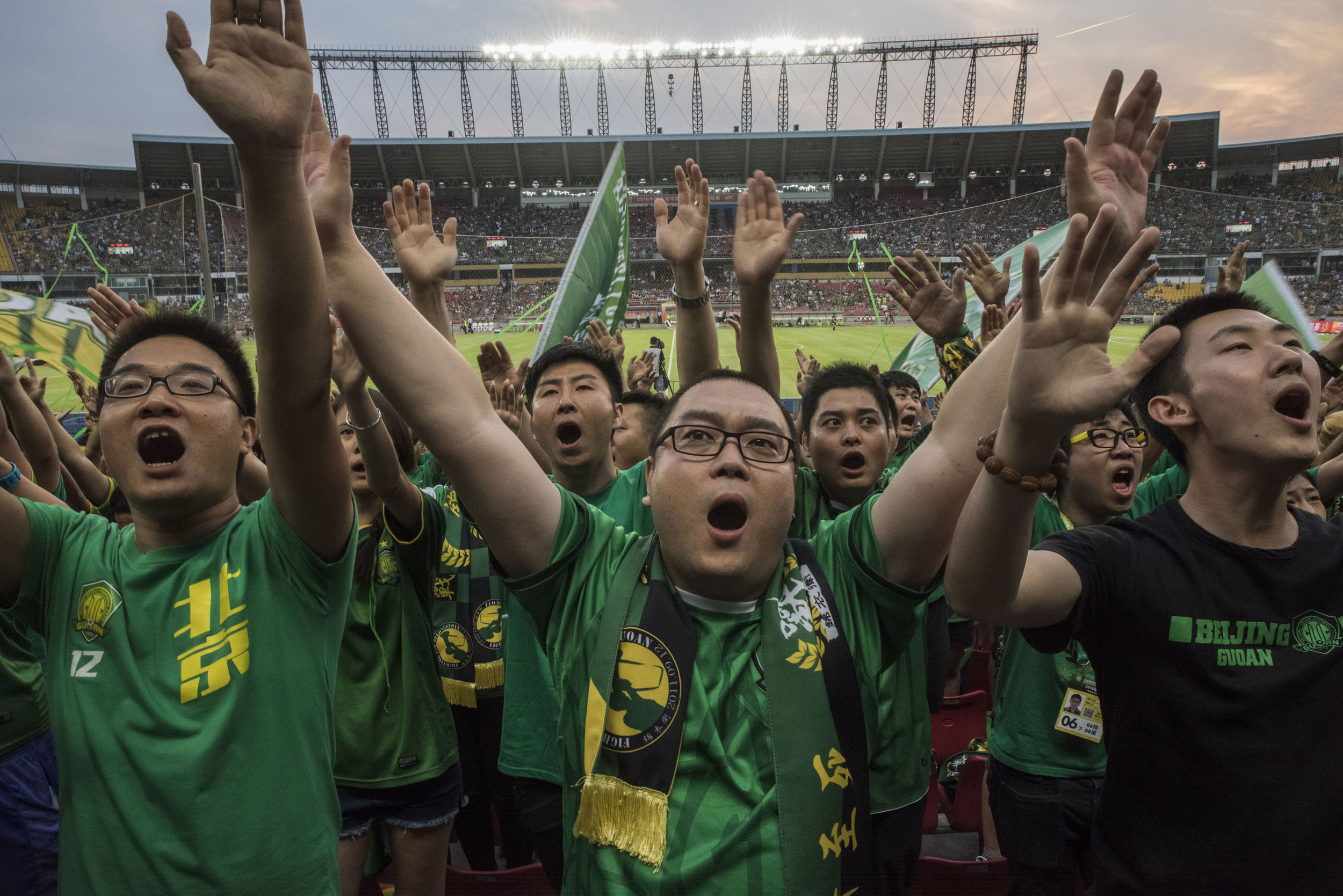 Supporters of the Beijing club Guoan cheering before the start of a game at the Workers Stadium. Guoan supporters are among the most fierce and unruly of Chinese football.