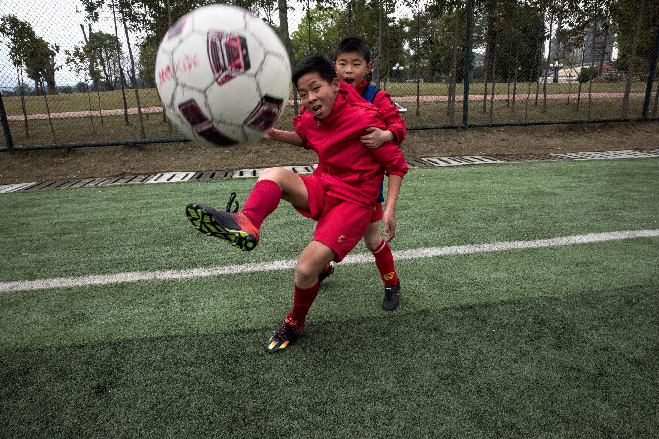 Students of the Evergrande football school training.