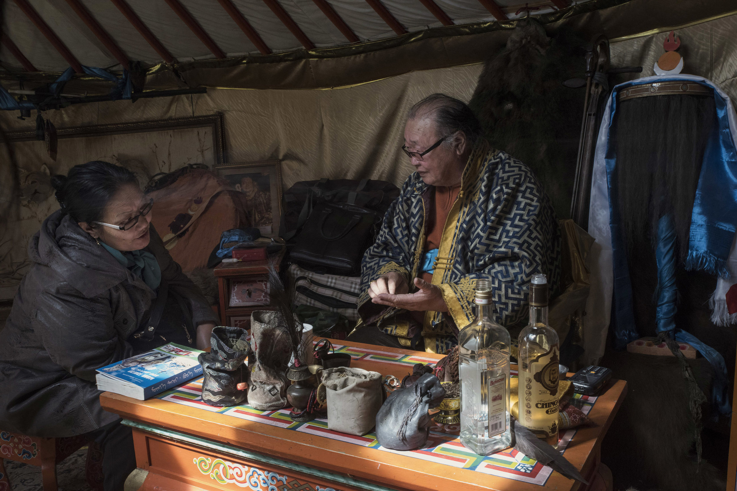 A woman visiting master shaman Byambadorj for his healing powers. When connected with their spirit shamans are believed to possess a wide-ranging array of powers, from curing health problems, to removing or casting curses, including fortune telling. These services can be a good source of income for shamans although many claim they are not paid for it.