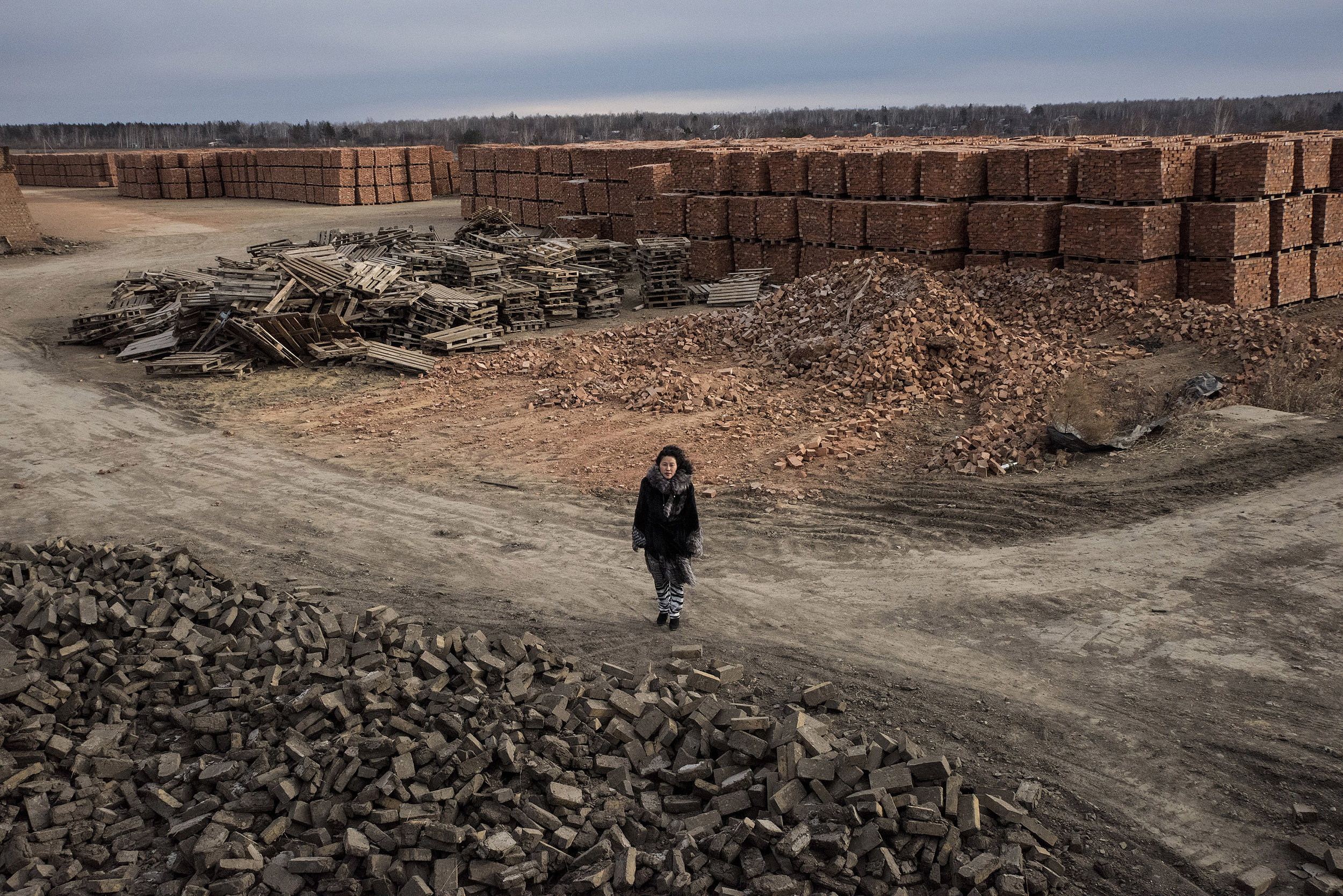 Li Lihua, a Chinese woman doing business in the Russian federation standing in a brick factory, one of four she owns in Blagoveshchensk.