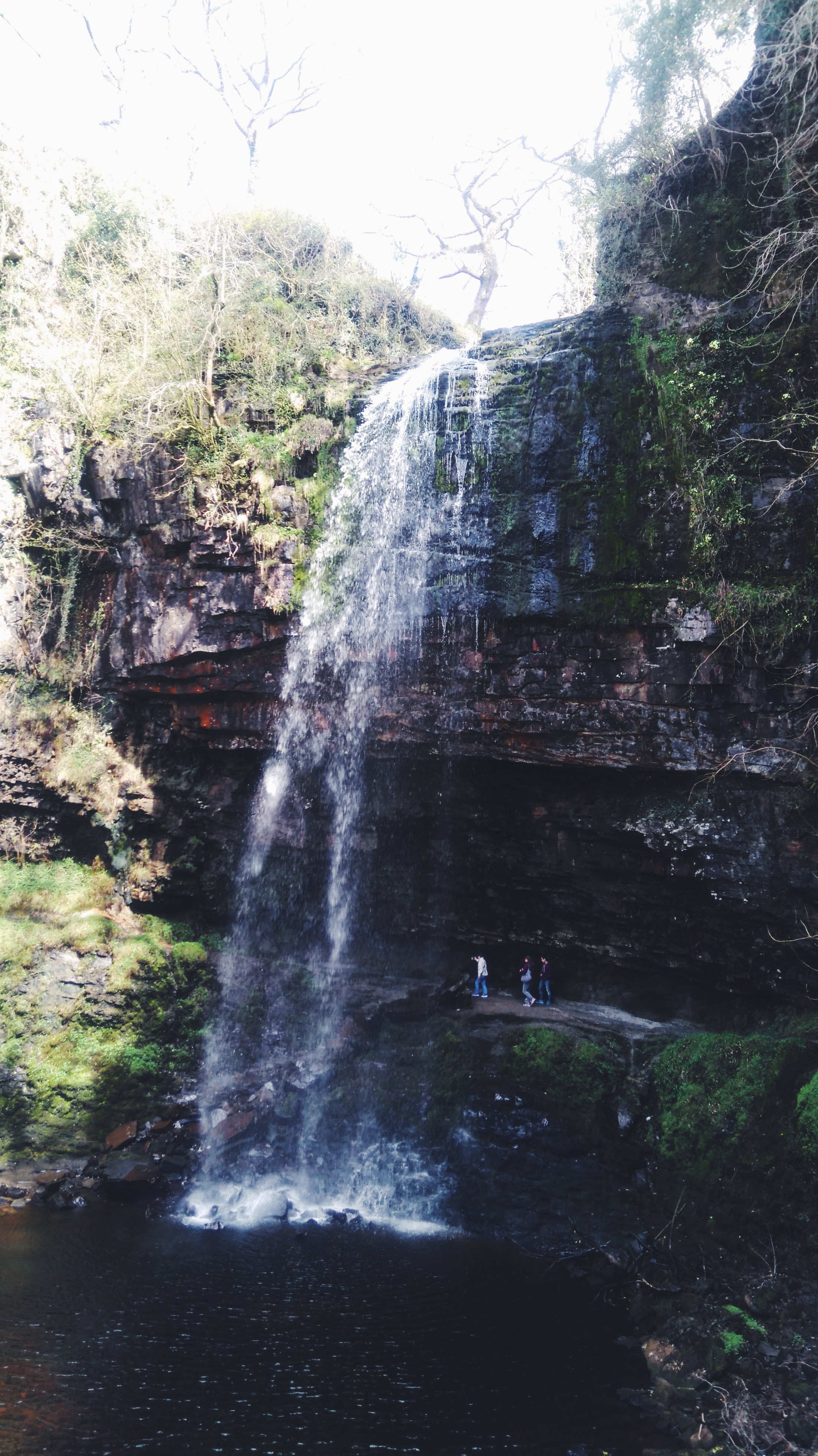Real Wales Tour guests exploring Henrhyd Falls in the Brecon Beacons