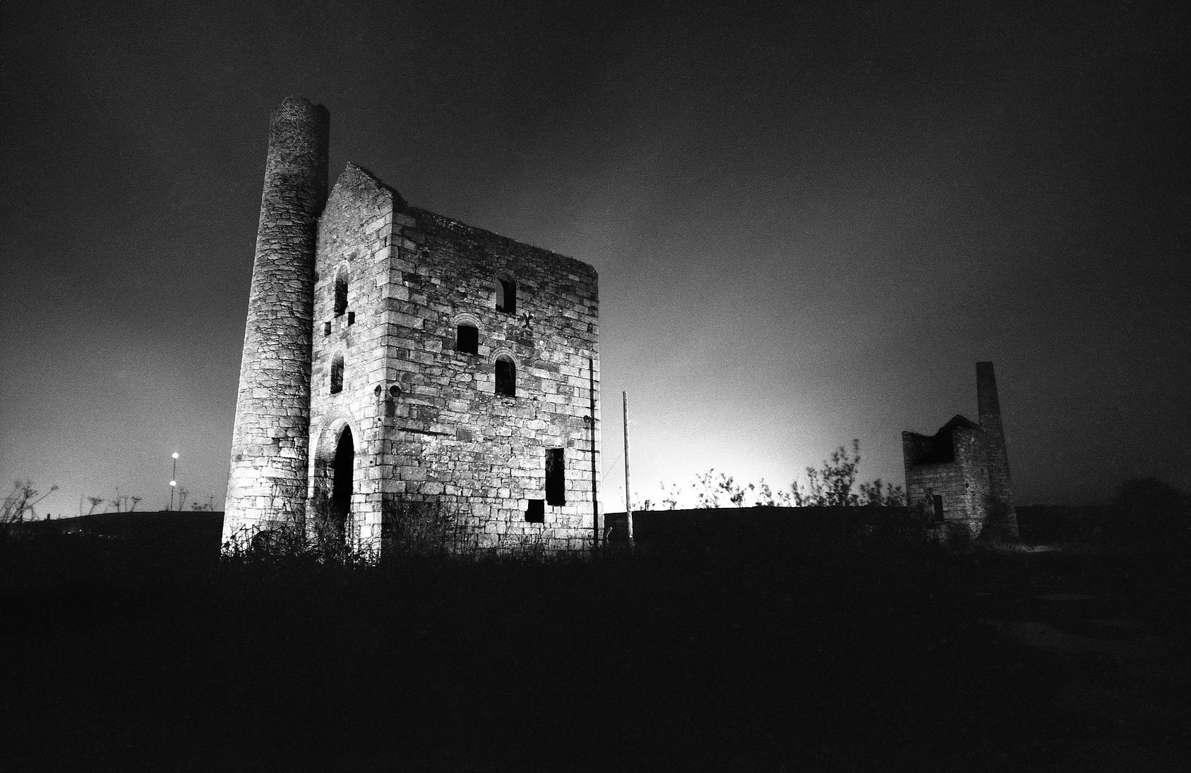 Grenville United Engine Houses, Cornwall, illuminated at night,