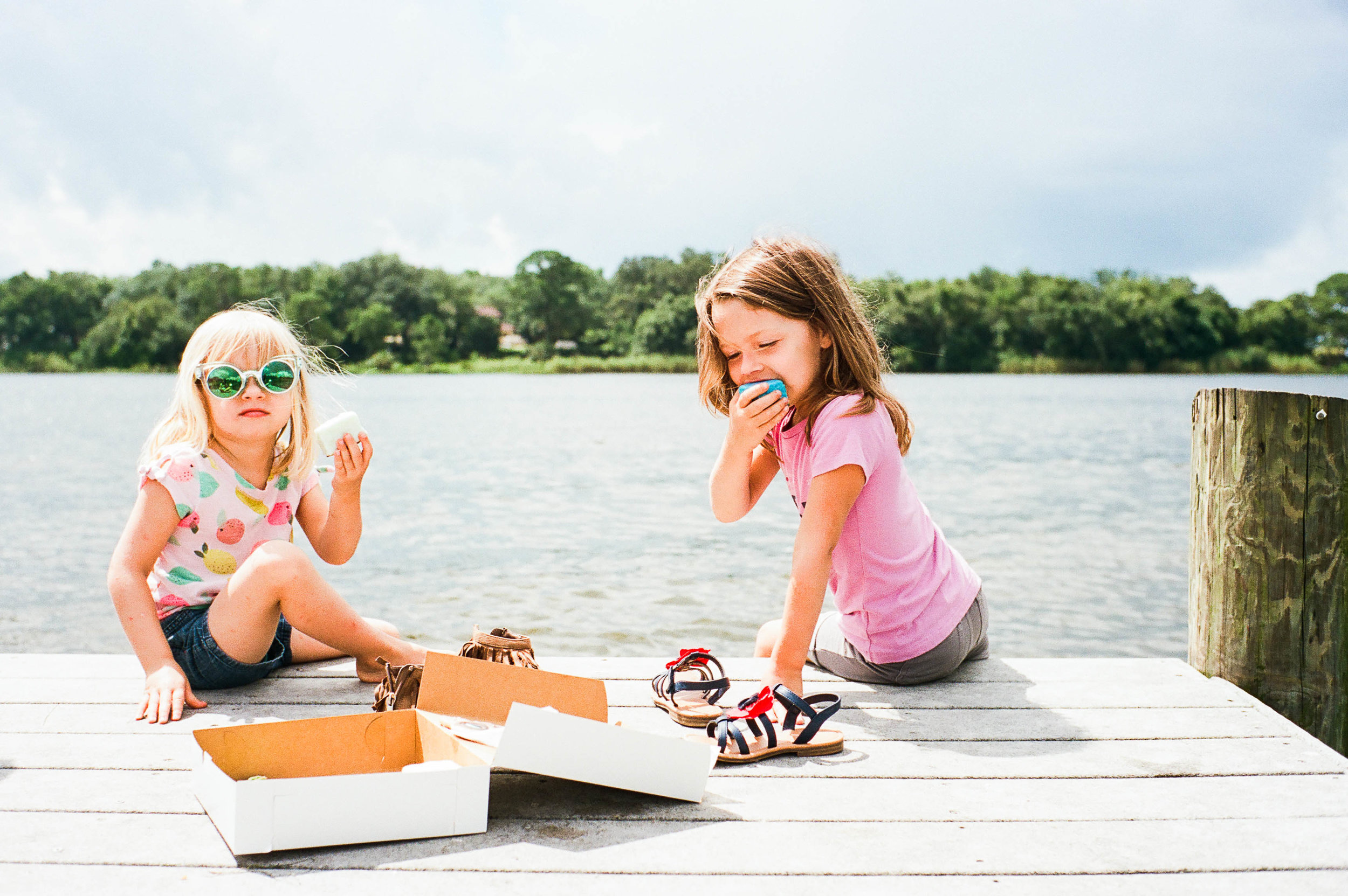 This picture means so much to me.  Here are my littlest loves, enjoying my favorite treat (petit fours) from my favorite childhood bakery, on the dock where we used to launch our boat when I was their age.