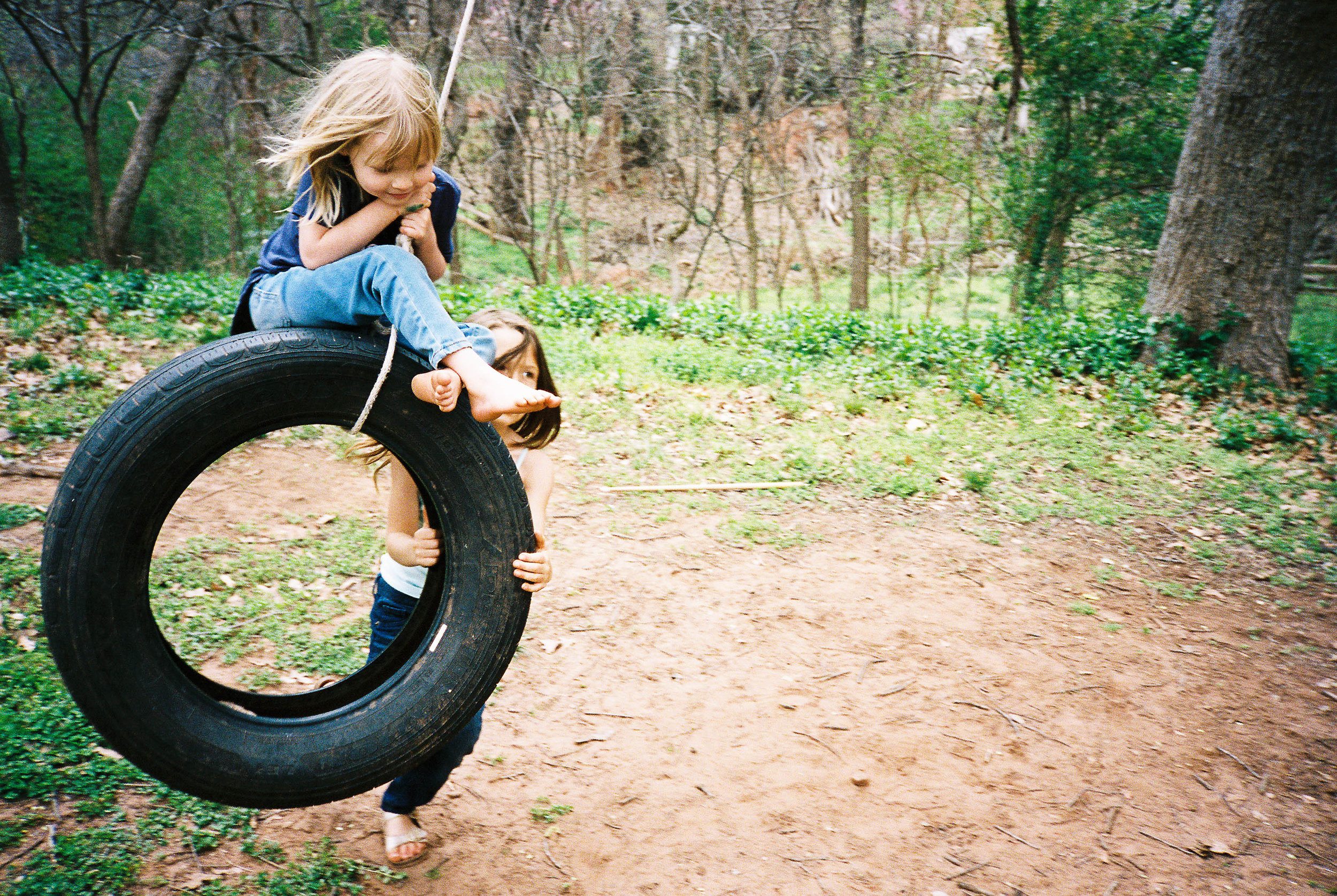 And when Mommy gets tired, sister fills in.  You can see how well loved this tire swing is by the immense patch of dirt beneath it.