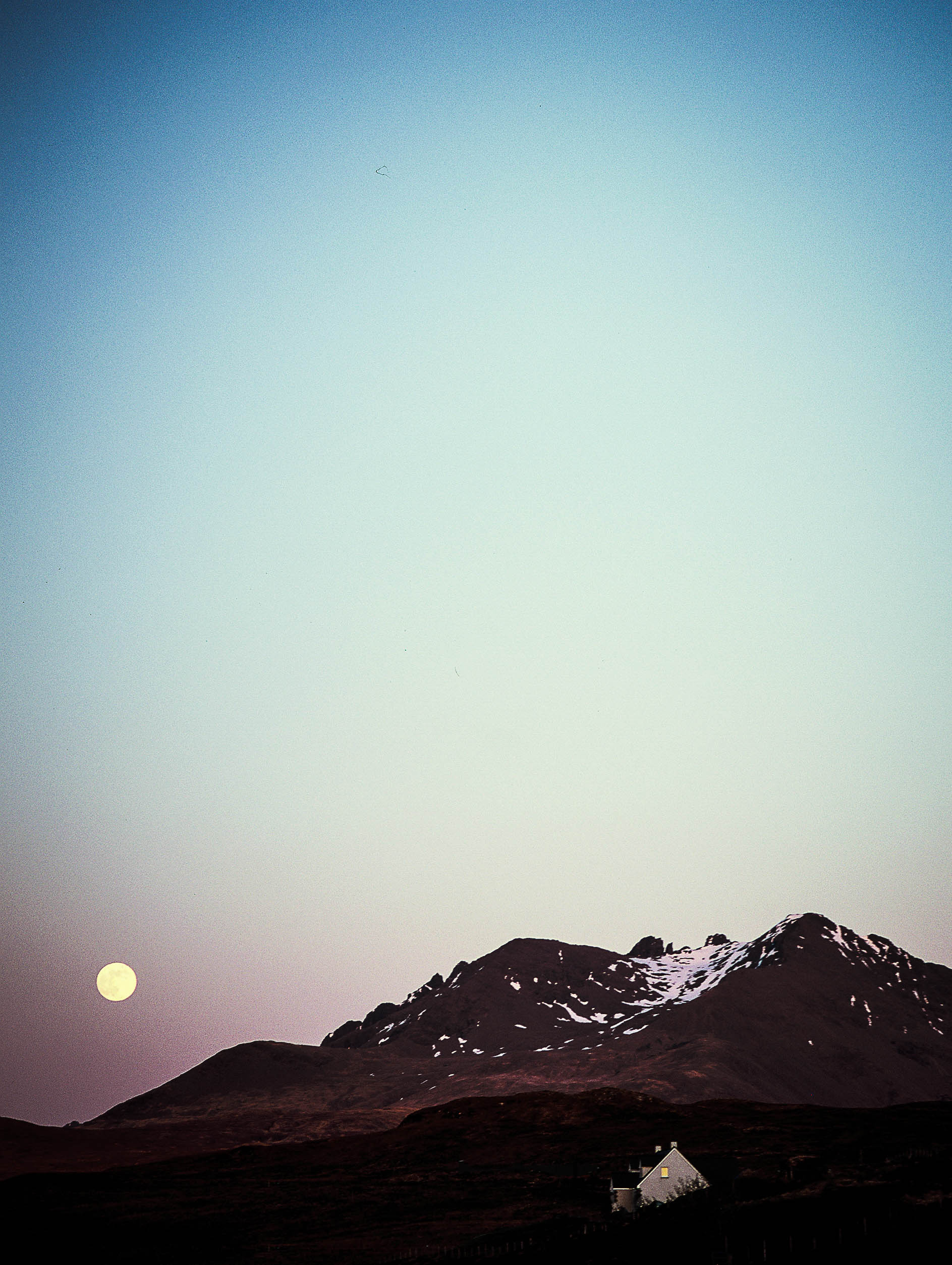 Moonrise over the Cuillin Mountains. I had my husband stop at the top of a cliff road with no shoulder so that I could climb on top of the car to get this shot. This was also my first time shooting slide film (which is really tricky), but glad I took the chance.
