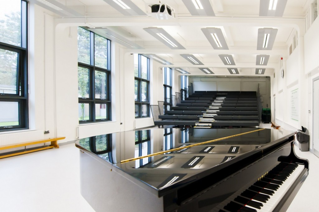 MAIN Hall : large digital screen, grand piano, stage area, and seating for up to 400 people.