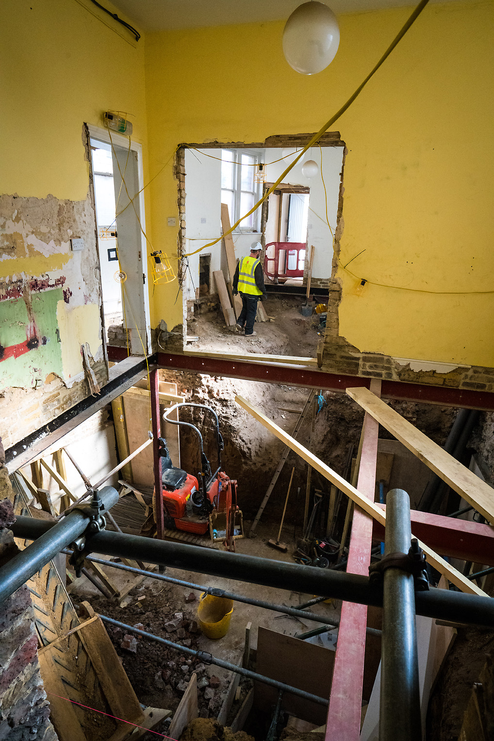 Team member moves through the extensive building works at the back of the Newington Green Meeting House
