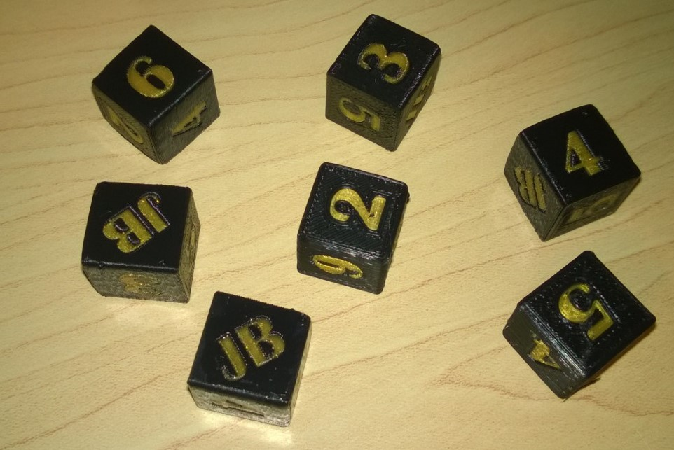 Personalized dice for a Reddit Gifts match.