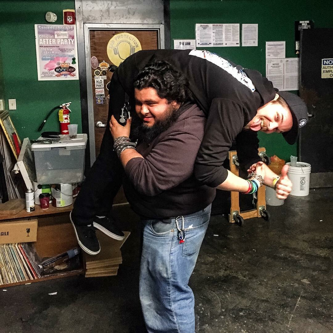 Sumo Max giving Kevin a lift before the Rock Shop show!