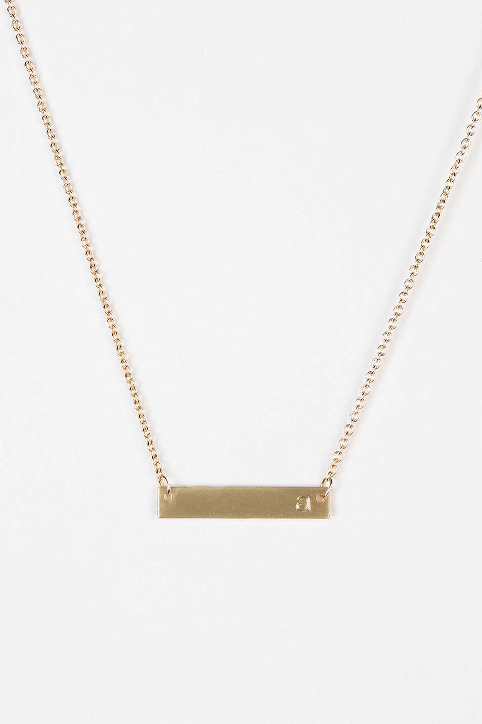 Initial bar necklace from  Urban Outfitters