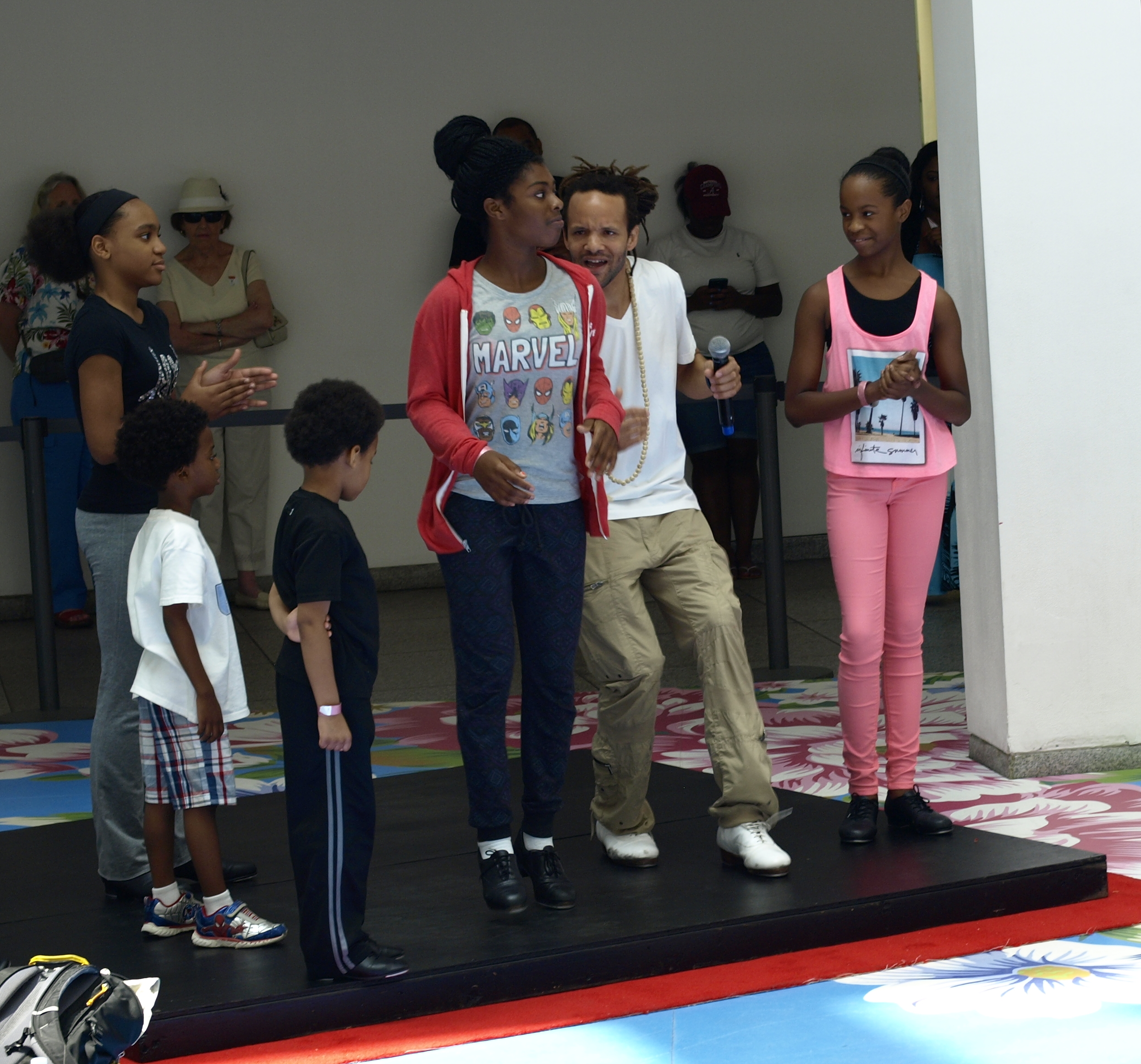 Savion Glover and a young lady rapped with their feet.