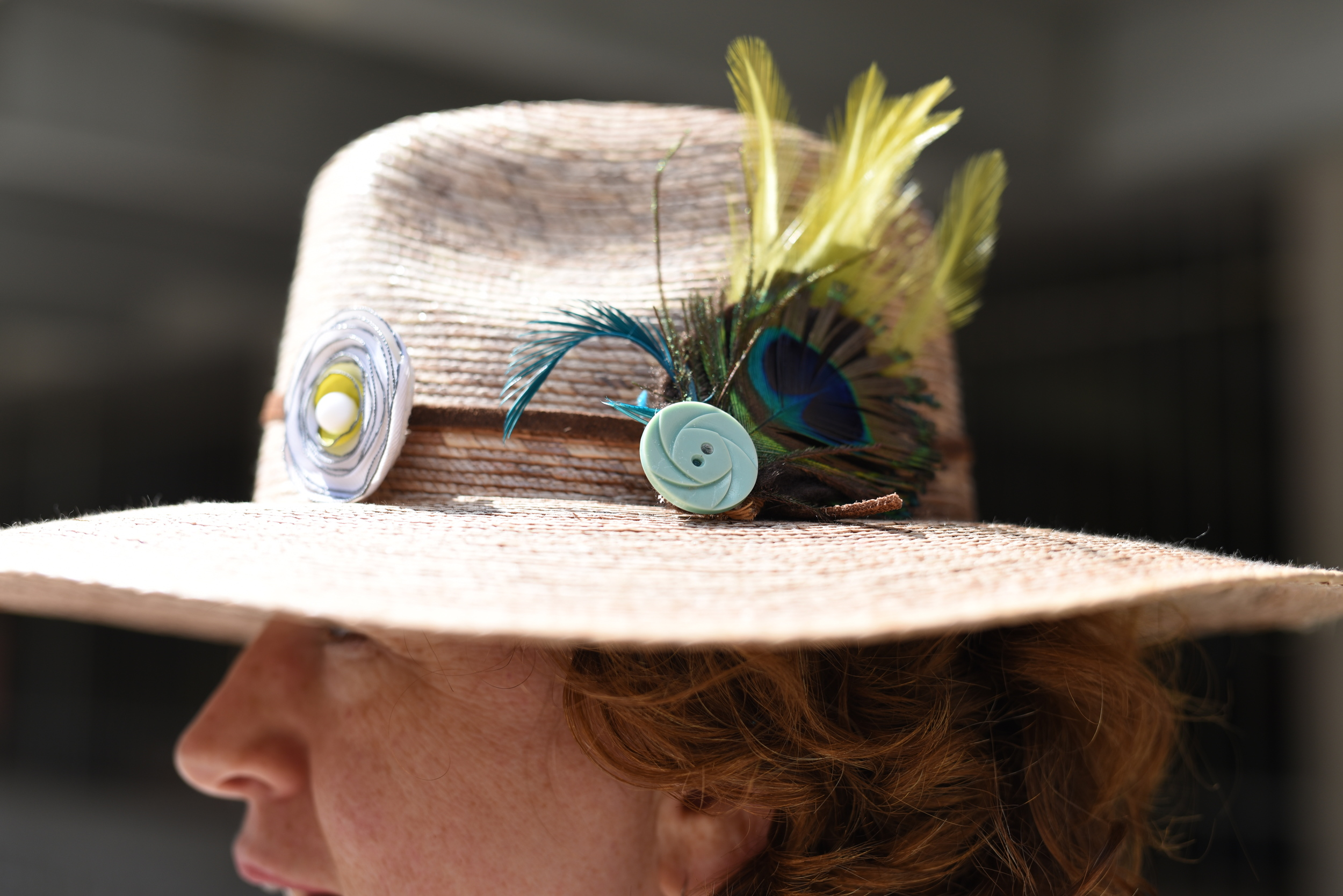 She makes hats. But not this one. She just added the peacock feather to this one. But if you want to see her awesome creations, go to  www.tinakite.com.