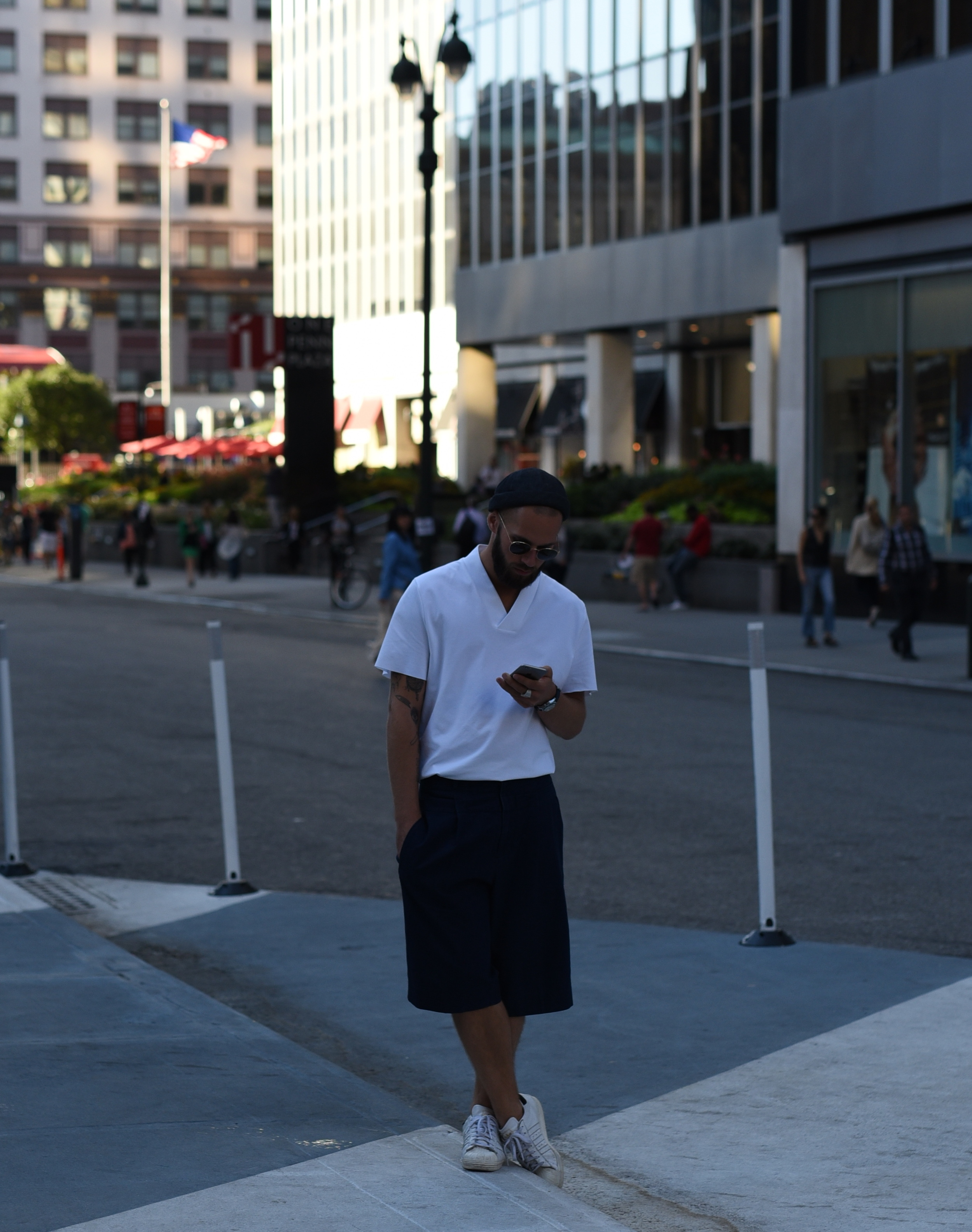 """Another """"normal"""" guy hanging out on the street - but this one is wearing a very fashion-forward outfit featuring culottes."""